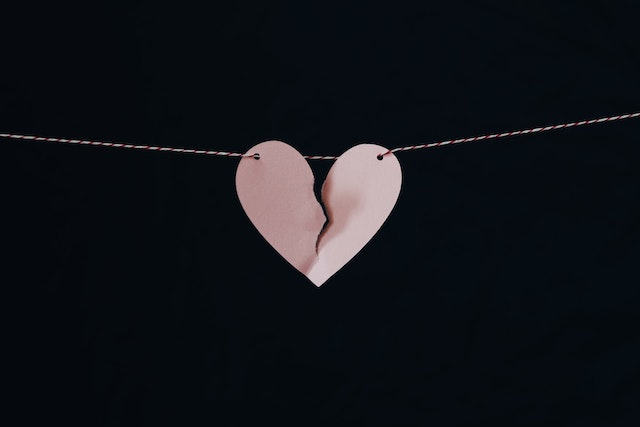 broken heart hanging on a line feature